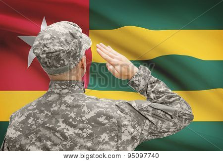 Soldier In Hat Facing National Flag Series - Togo