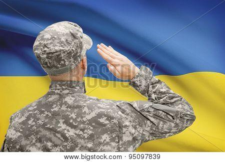 Soldier In Hat Facing National Flag Series - Ukraine