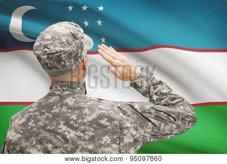 Soldier In Hat Facing National Flag Series - Uzbekistan