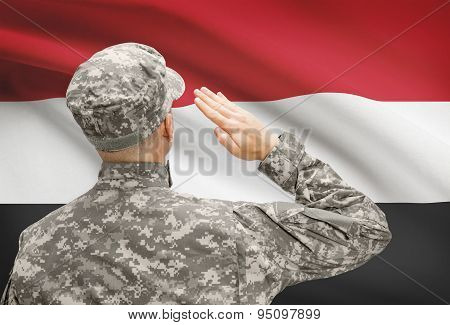 Soldier In Hat Facing National Flag Series - Yemen