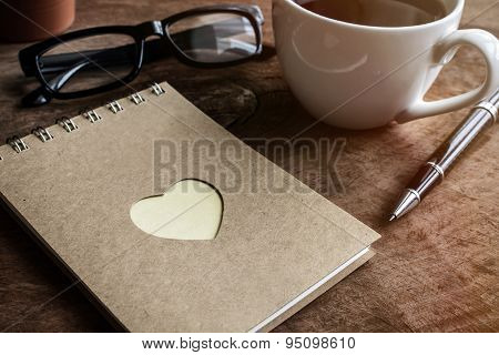 Cup Of Coffee With Notebook And Heart Shape