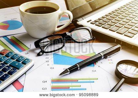 Laptop On Desk Office And Graph Analysis Spreadsheet, Business Finance