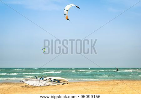 Kite Surfing In Desert Windy Beach With Windsurf Board - Exlcusive AdventuresTropical Destinatio