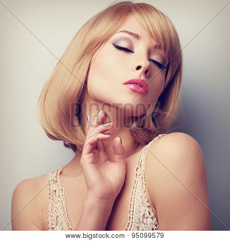 Beautiful Blond Short Hair Woman With Closed Eyes Touching Neck Skin. Toned Closeup Portrait