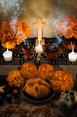 pic of altar  - Traditional mexican Day of the dead altar with pan de muerto and candles - JPG