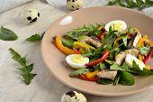 foto of quail  - Fish salad with quail eggs - JPG