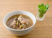 stock photo of thai cuisine  - Thai Cuisine and Food A Bowl of Thai Clear Spicy Hot and Sour Soup with Beef Entrails - JPG