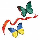 picture of turkmenistan  - Two butterflies fluttering with flags of Ukraine and the Turkmenistan - JPG