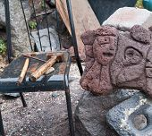 stock photo of stone sculpture  - Lava stone sculpture of a stylised woman - JPG