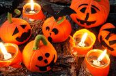 picture of horror  - Amazing halloween background in red color group of handmade pumpkin on night light from candle make scary horror symbol halloween is tradition season - JPG