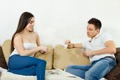 picture of foreplay  - Young adult couple perform foreplay - JPG