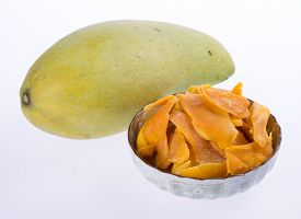 stock photo of mango  - mango dry in bowl or dried mango slices - JPG