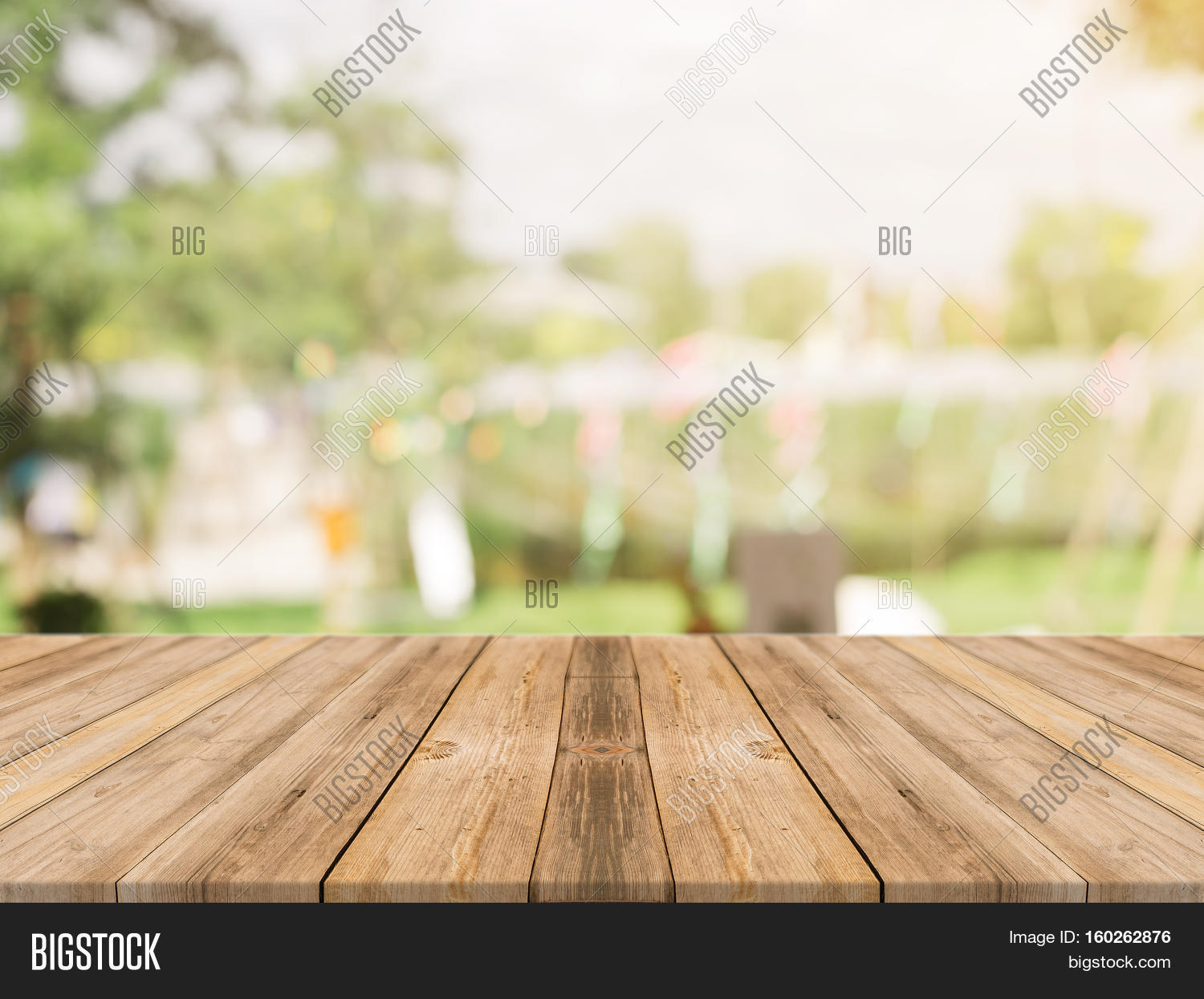 Picnic Table Background wooden board empty table top on of blurred background. perspective