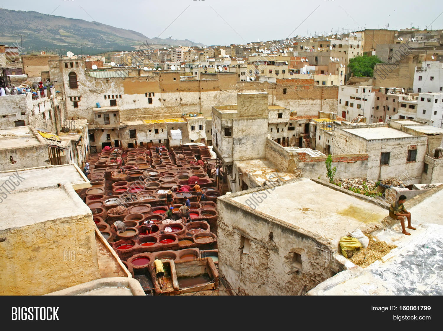 fez morocco may city skyline and view of rooftops and workers in