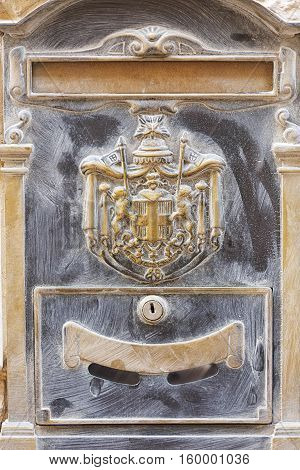 Old historical bronze brass letterbox in Malta