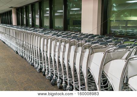 luggage carts at airport terminal