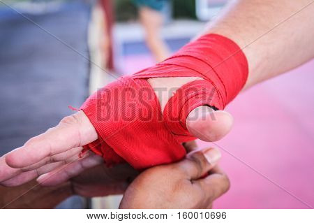 Coach doing the red bandage in the boxer's hand