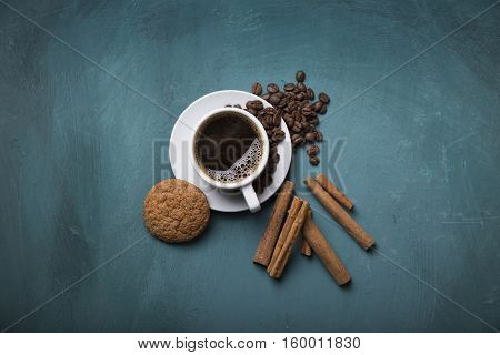 Cup of coffee with brown sugar on a wooden table