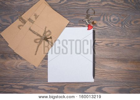 Envelope And Letter On Wooden Brown Background