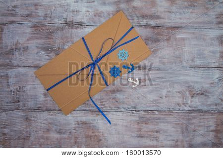 Kraft Envelope With Blue Ribbon And Ornaments In Marine Style