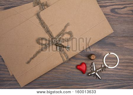 Kraft Envelopes Tied With Twine On A Wooden Table