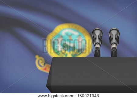 Pulpit And Two Microphones With Usa State Flag On Background - Idaho