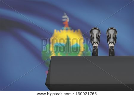 Pulpit And Two Microphones With Usa State Flag On Background - Vermont