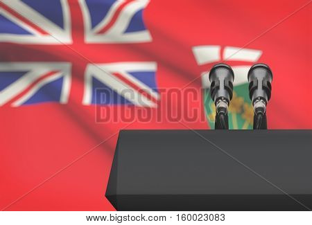 Pulpit And Two Microphones With Canadian Province Flag On Background - Ontario