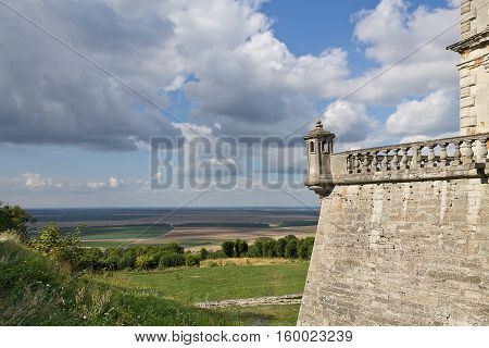 landscape with cloudy sky and part of Pidhirtsi Castle in Ukraine