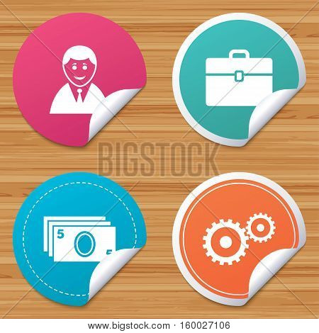 Round stickers or website banners. Businessman icons. Human silhouette and cash money signs. Case and gear symbols. Circle badges with bended corner. Vector