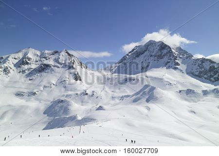Winter landscape of French skiing resort Les Arcs with snowy Alps peaks ski slopes