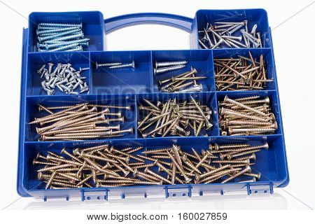 Different Screws and other Parts sorted in a plastic box