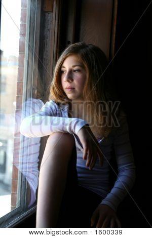 Thoughtful Girl At Window