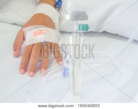 Saline Intravenous (iv) Drip On Children Hand In Hospital. Health Care And Medical Equipment Concept