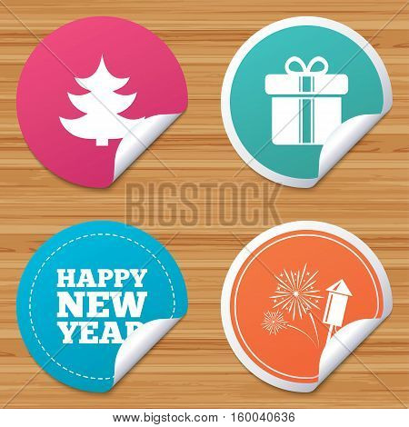 Round stickers or website banners. Happy new year icon. Christmas tree and gift box signs. Fireworks rocket symbol. Circle badges with bended corner. Vector
