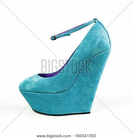 stylish female blue shoes on white background