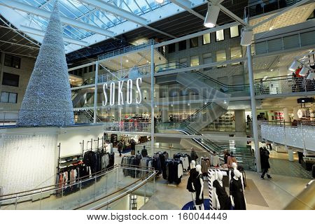 HELSINKI, FINLAND - NOVEMBER 26, 2016: People in the central department store Sokos decorated for Christmas. Sokos is a chain of department stores in Finland that is part of the S Group