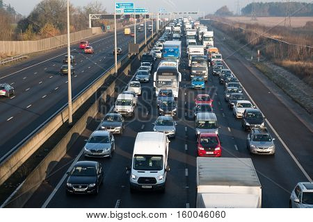 Traffic on the busy British motorway M1 in a cold frosty morning