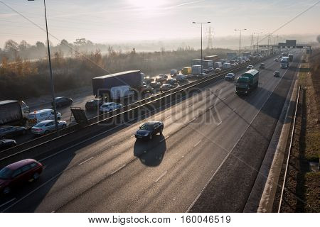 London, UK, 05 December 2016: Traffic jam on the British M1 motorway in a cold frosty morning