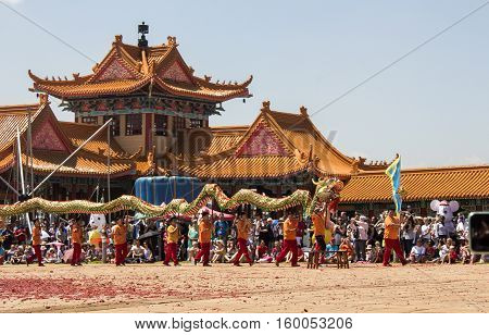 Bronkhorstspruit, South Africa - February 06, 2016: Chinese New Year Parade next to the Chinese Nan Hua Temple in South Africa. Dancing with the traditional colorful Chinese Lion as a part of ethnic Chinese culture.