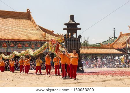 Bronkhorstspruit ,South Africa - February 06, 2016: Chinese New Year Parade next to the Chinese Nan Hua Temple in South Africa. Dancing with the traditional colorful Chinese Lion as a part of ethnic Chinese culture.