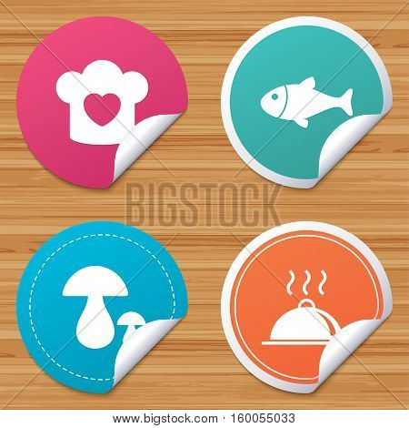 Round stickers or website banners. Chief hat with heart and cooking pan icons. Fish and boletus mushrooms signs. Hot food platter serving symbol. Circle badges with bended corner. Vector