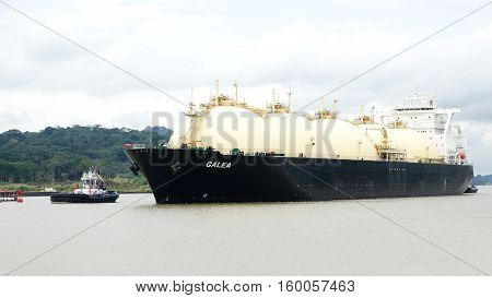 PANAMA-NOV 19 2016: Post Panamax vessel GALEA crossing the Panama Canal Galea is a LNG Tanker one of the huge ships that now can use the water way.