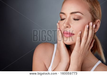 Beautiful middle aged woman touching her face,  skincare , perfect skin