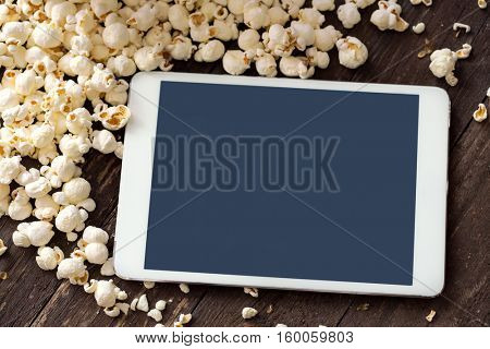 fresh popcorn with digital touch screen tablet