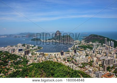 Aerial view of the Sugarloaf mountain, Botafogo bay, ocean, Botafogo and Humaita districts of Rio de Janeiro, Brazil