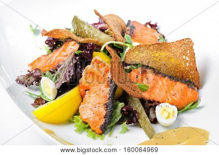Caesar salad with grilled salmon and quail eggs