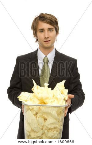 Businessman With Waste Paper Basket