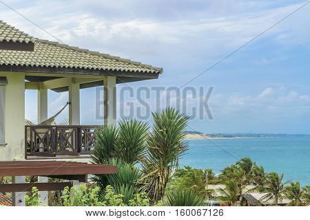 Detail view of roof and balcony of elegant waterfront house at top of hill in Tibau do Sul a watering place located in Brazil