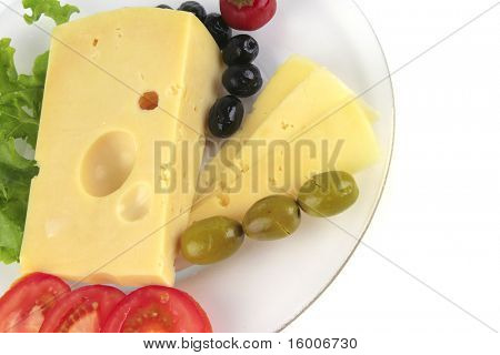 yellow cheese and vegetables on transparent dish